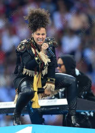 Singer Alicia Keys performs on stage before the match