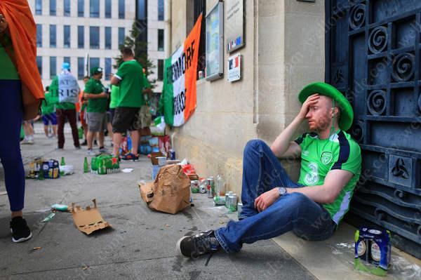 An Irish fan feels the effects of a heavy night