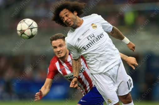 Marcelo of Real battles with Saul Niguez of Atletico