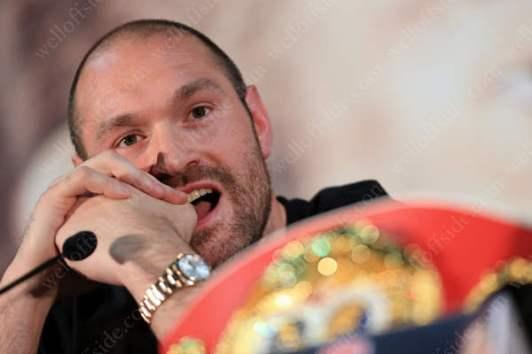 Tyson Fury looks on
