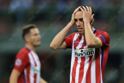 Diego Godin of Atletico looks dejected