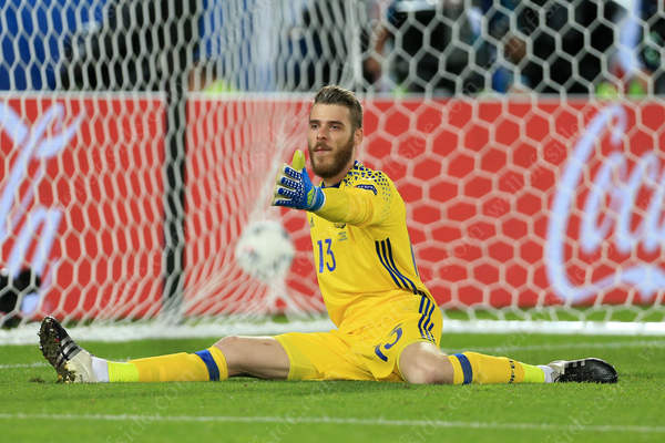 With the ball buried in the net behind him, Spain goalkeeper David De Gea looks helpless after Croatia's winning goal beat him at his near post