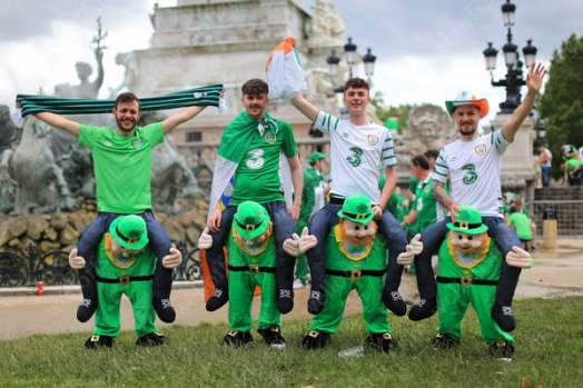 Irish fans receive a helping hand on their way to the Fanzone