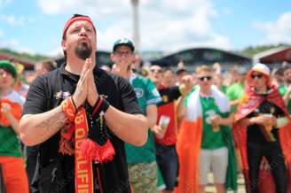 A Belgium fan prays for his side