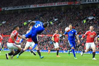 Wes Morgan of Leicester scores their 1st goal against Manchester United