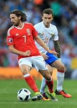 Joe Allen of Wales battles with Pavel Mamaev of Russia