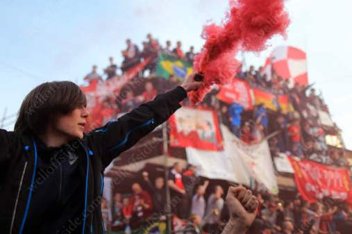 A Liverpool fan sets off a red flare before their side's UEFA Europa League Semi-Final (2nd Leg) match against Villarreal