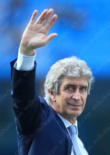 Man City manager Manuel Pellegrini waves farewell after his last home game in charge