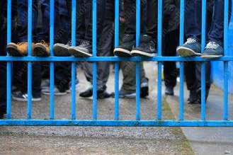 Fans clamber onto a gate to get a better view in Carlisle