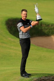 TROON, SCOTLAND - JULY 17: Henrik Stensen (SWE) holds the Claret Jug aloft after winning the 145th Open Championship at Royal Troon Golf Club on 17th July 2016 in Troon, Scotland. Photo by Simon Stacpoole/SilverHub 0203 174 1069 / 07711 972644