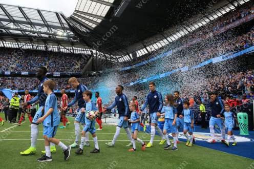 Ticker tape welcomes the players onto the Etihad Stadium pitch