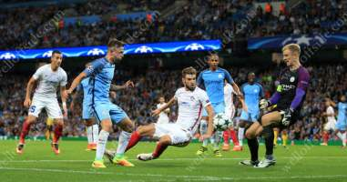 Joe Hart makes a save on his final UEFA Champions League appearance for Man City