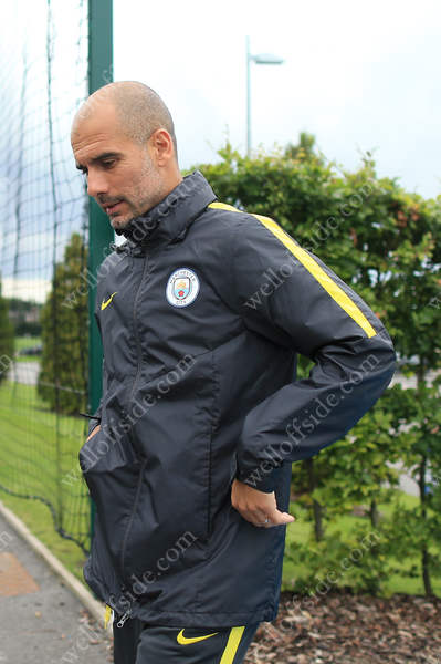 Pep Guardiola emerges to take charge of the open training session at Man City