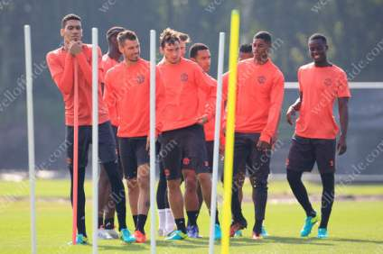 Man Utd players line up during a training session at the AON Training Complex in Carrington
