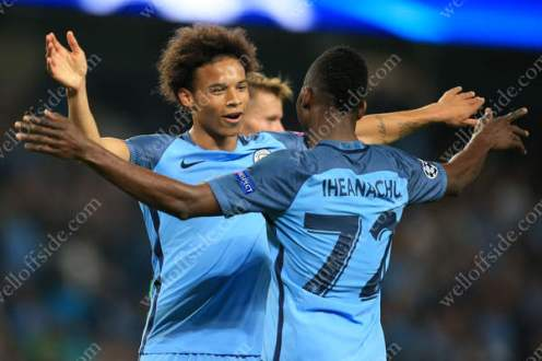 Kelechi Iheanacho of Man City celebrates with teammate Leroy Sane after scoring their 4th goal