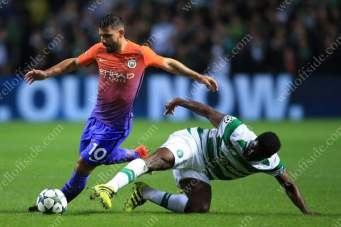 Sergio Aguero of Man City battles with Kolo Toure of Celtic during their UEFA Champions League match at Parkhead
