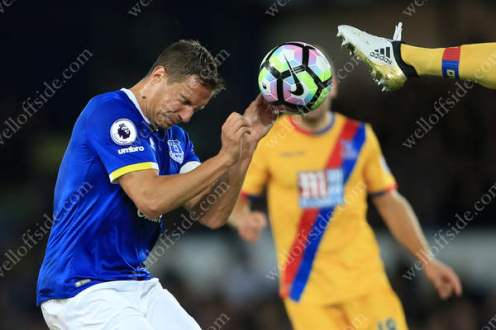 Phil Jagielka of Everton winces as a boot comes towards his head during their Premier League match against Crystal Palace