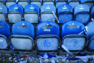 The Huddersfield fans of the 1908 Club leave stickers on the seats