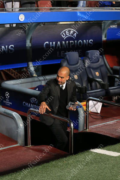 Man City manager Pep Guardiola emerges from the tunnel at the Nou Camp before his side take on FC Barcelona in the UEFA Champions League