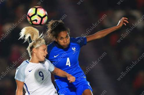 Rachel Daly of England battles with Laura Georges of France
