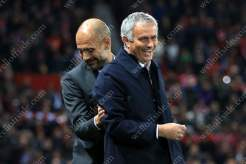 Man City manager Pep Guardiola (L) greets Man Utd manager Jose Mourinho before their EFL Cup 4th Round match