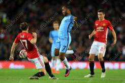 Daley Blind of Man Utd battles with Raheem Sterling of Man City