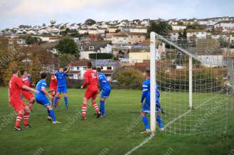 Action from inside the penalty box as rows of houses overlook the Coombe Valley pitch