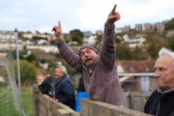 A Teignmouth fan fires up the visiting fans