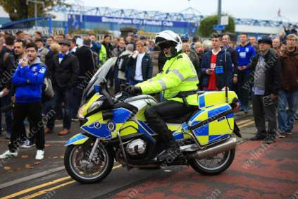 Police stand by as Birmingham City fans await the arrival of the Aston Villa supporters before the derby