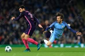 Andre Gomes of Barcelona battles with David Silva of Man City
