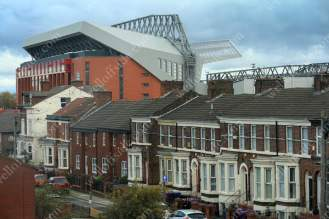 The redeveloped Main Stand at Anfield soars high above the nearby terraced houses