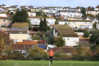 The Teignmouth goalkeeper shows his dejection as rows of houses overlook the pitch during the Carlsberg South West Peninsula League Division One East match between Teignmouth and Brixham