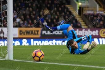 Burnley goalkeeper Tom Heaton tips the ball past the post