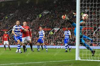 Wayne Rooney of Man Utd watches his shot bounce past Reading goalkeeper Ali Al-Habsi and into the net to equal the club's all-time goalscoring record with Sir Bobby Charlton
