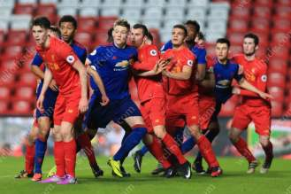 Liverpool's U23 players tussle for space with their Man Utd counterparts