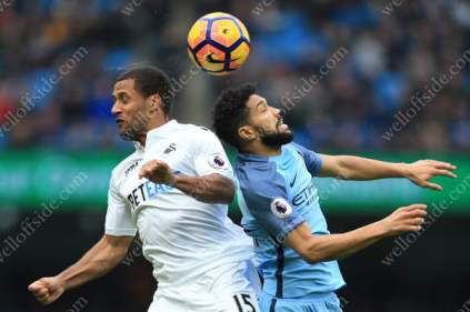Wayne Routledge of Swansea battles with Gael Clichy of Man City