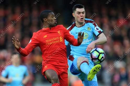 Georginio Wijnaldum of Liverpool battles with Michael Keane of Burnley