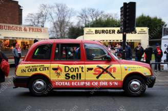 A Liverpool taxi covered in livery promoting a boycott of The Sun newspaper