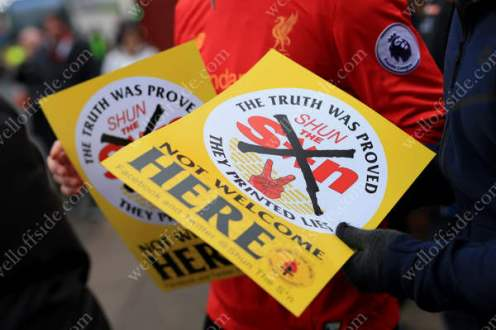 Flyers are handed out before the game between Liverpool and Tottenham Hotspur encouraging fans not to buy The Sun newspaper