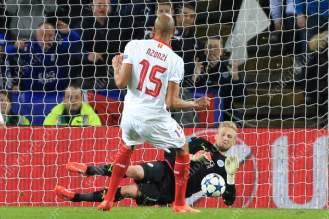 Leicester goalkeeper Kasper Schmeichel saves a penalty from Steven N'Zonzi of Sevilla