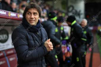 Chelsea manager Antonio Conte feels the bitter cold at Turf Moor