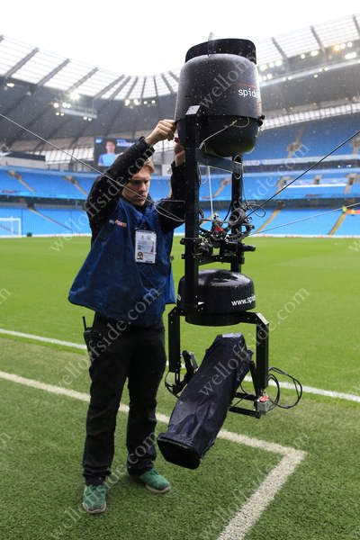 A Sky Sports technican adjusts the SpiderCam overhead television (TV) camera before the Premier League match between Manchester City and Liverpool