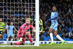 Kelechi Iheanacho of Man City scores their 5th goal to complete their demolition of Huddersfield Town