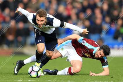 Christian Eriksen of Spurs brushes aside Joey Barton of Burnley