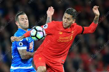 Jack Wilshere of Bournemouth battles with Roberto Firmino of Liverpool