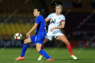 Steph Houghton of England battles with Ilaria Mauro of Italy