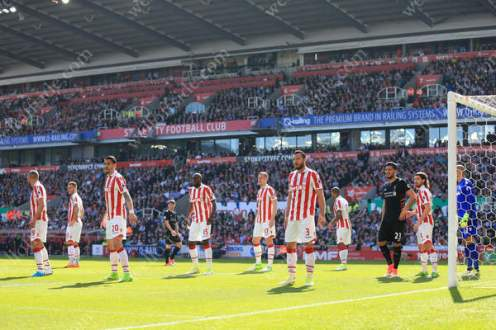 Stoke players spread out to defend a corner against Liverpool
