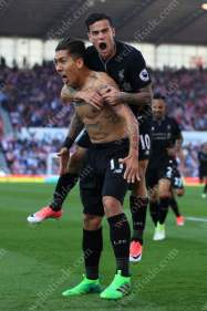 Roberto Firmino of Liverpool (L) celebrates with teammate Philippe Coutinho after scoring their 2nd goal