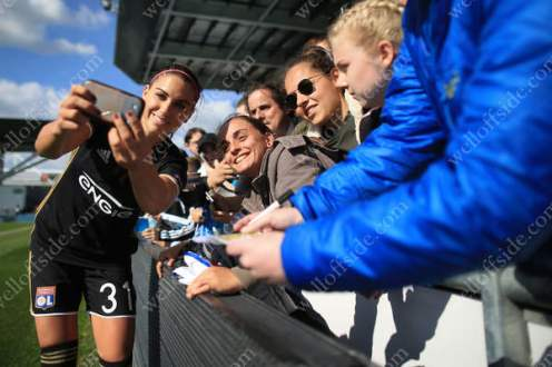 American poster girl Alex Morgan of Lyon poses for selfies with fans after the match