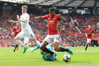 Swansea goalkeeper Lukasz Fabianski pulls out of a challenge with Marcus Rashford of Man Utd, but it wasn't enough to convince the referee not to award a penalty